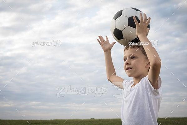 عکس کودک فوتبال دوست