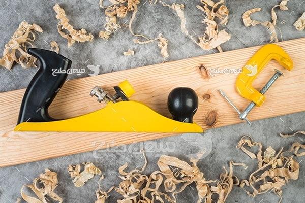 عکس کار با چوب