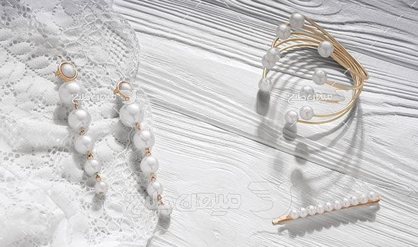 عکس تبلیغاتی جواهرجواهرات مروارید