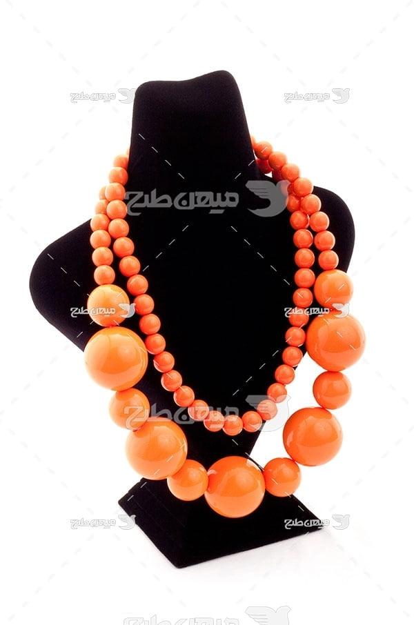 عکس گردنبند سنگ نارنجی رنگ
