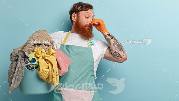 عکس شستن لباس های کثیف و بد بو