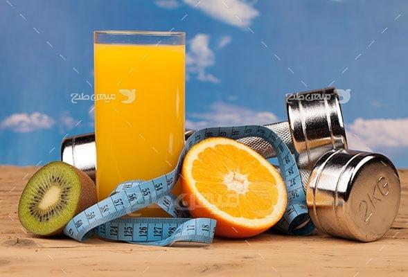 عکس تبلیغاتی ورزش وزنه فلزی سبک