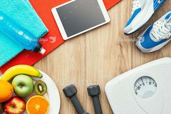 عکس تبلیغاتی ورزش ظرف میوه