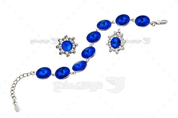 عکس ست گوشواره و دستبند نقره با نگین الماس آبی