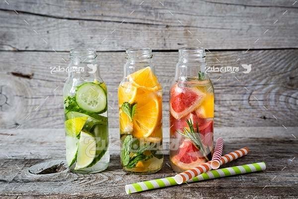 عکس میوه،پرتقال،خیار سبز و پرتقال قرمز