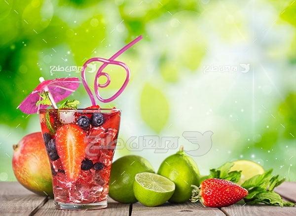 عکس سالاد میوه و لیمو و توت فرنگی