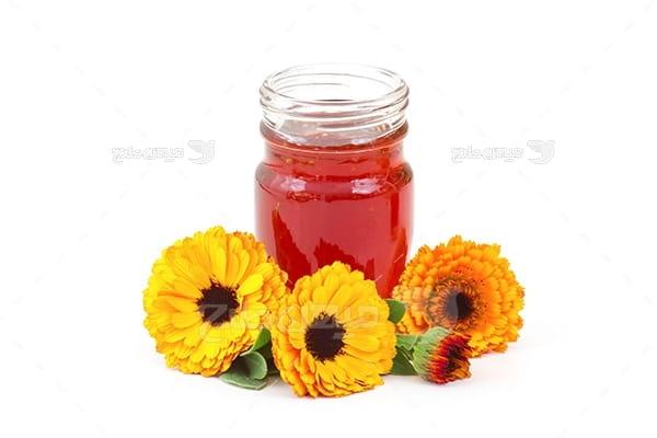 عکس شیشه عسل و گل