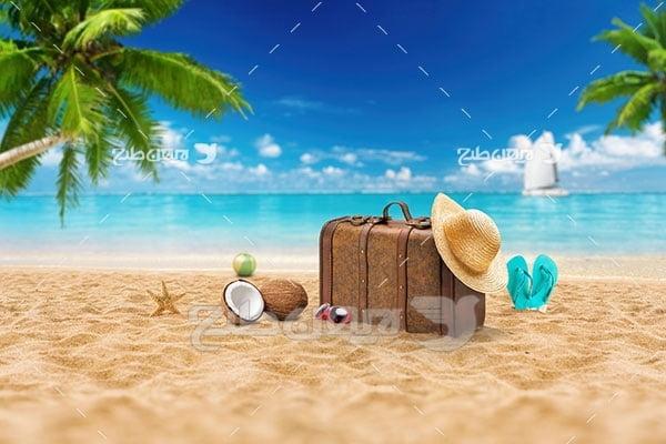 تصویر مسافرت و گردشگری، چمدان ، ساحل،دریا و نخل