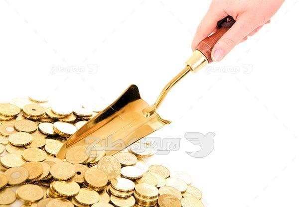 عکس پول و سکه طلا و دست