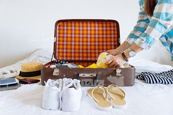 تصویر چمدان و وسایل سفر
