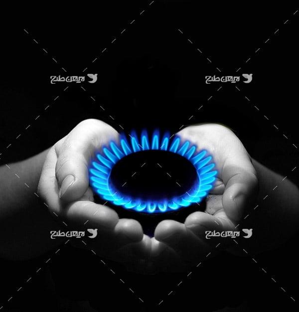 تصویر صنعتی شعله گاز و دست