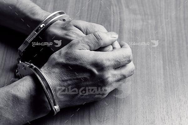 عکس دستبند زندانی