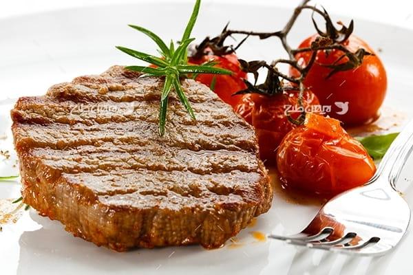 عکس غذای گوشت و گوجه فرنگی پخته