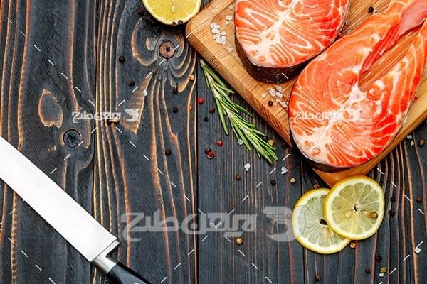عکس گوشت ماهی بریده شده و لیمو