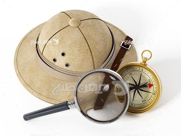 عکس کلاه و قطب نما و ذره بین