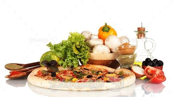 تصویر با کیفیت از پیتزا و سبزی